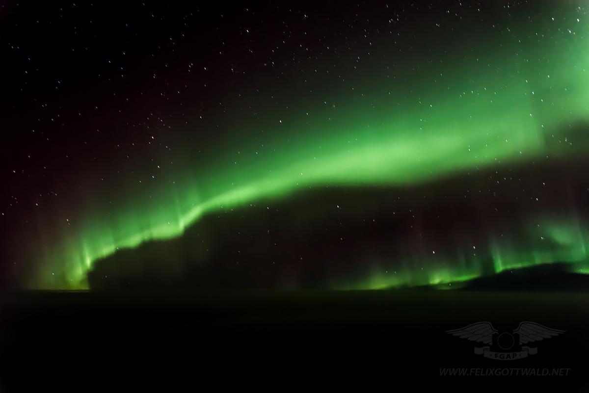 Aurora Borealis (polar light or northern light) near Greenland and over the North Atlantic Ocean 08