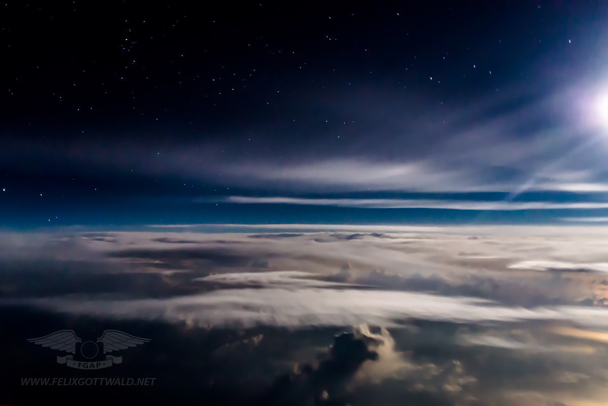 Flying above the clouds during a moonlit night 01